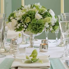 Love green and white centerpieces!  like the shape and the silver pedestal with the wedding color theme