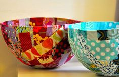 Wrap papier mache around the fat end of a balloon, allow it to dry and then glue strips of fabric over the top.