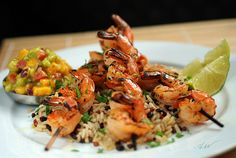 Lime and garlic grilled shrimp skewers with cilantro lime brown rice medley.