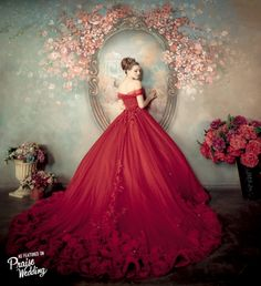 "If you're looking for a gown with a ""wow"" factor for your big day, this one will do! Stunning off-the-shoulder red gown with a romantic rosy train."