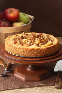 Caramel Apple Pecan Cheesecake is a caramel cheesecake topped with cooked apples and pecans tossed in caramel sauce.