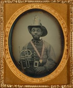1855-1856 fireman in uniform holding a brass musical instrument;  daguerreotype, hand-colored; 6 x 4.9 cm (2 3/8 x 1 15/16 in.); 84.XT.1582.3