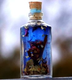 HEX BANE  Oil is handcrafted with:    Bay Leaf  Sweet Cinnamon   chips from Madagascar  Myrrh resin  Red Rose Petals  Blue Vervain  Red Wine  Hyssop   Sea Salt     Mix all together in a bottle, and let stew a while.  Use a tiny drop on yourself when going out... and sprinkle a drop on each corner of your house.... then keeping the bottle in a central location on your alter!     Use this powerful blend to eliminate baneful energies, break hexes, remove jinxes and uncross conditions.