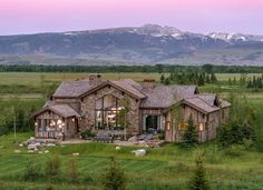 Timber frame home has a breathtaking backdrop of Wyoming's mountains