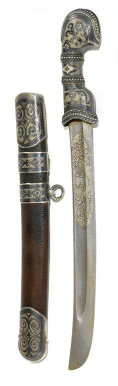 A SILVER-GILT AND NIELLO KINDJAL FORMED AS A SMALL SHASQUA, LATE 19TH CENTURY - EARLY 20TH CENTURY