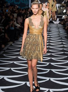 Golden girl Karlie Kloss on the Fall 2014 runway in a gold wrap dress from the 40th anniversary collection. See more on World of DVF: http://on.dvf.com/1KauiZh #FlashbackFriday