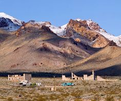 Rhyolite is a ghost town in Nye County, in the U.S. state of Nevada. It is located in the Bullfrog Hills, about 120 miles (190 km) northwest of Las Vegas, near the eastern edge of Death Valley. The town used to have 10,000 citizens during the goldrush