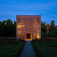 Pottery studio in Vietnam sheltered by a perforated cube of clay bricks Terra Cotta Studio by Tropical Space – Inhabitat - Green Design, Innovation, Architecture, Green Building Atelier Architecture, Brick Architecture, Ancient Architecture, Contemporary Architecture, Terracota, Vietnam, Ceramic Studio, Brick Building, Green Building
