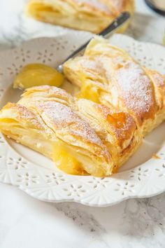This Lemon Cream Cheese braid is ready in under 30 minutes! Flaky pastry filled with lemon curd and cream cheese to create a sweet, yet tart dessert everyone will love!