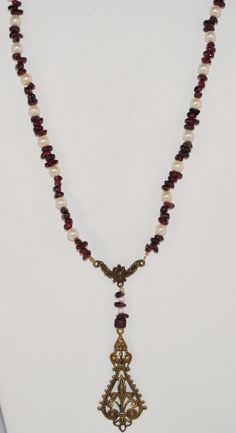 Check out this item in my Etsy shop https://www.etsy.com/listing/264337492/beaded-necklace-natural-garnet-stones