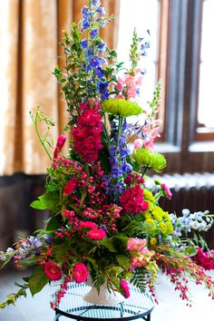 our ceremony flowers - blue, hot pink and green wedding colors