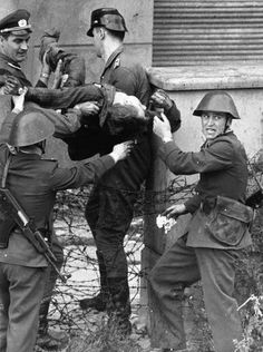 A dying Peter Fechter is carried away by East German border guards who shot him when he tried to flee to the west Aug 17, 1962.