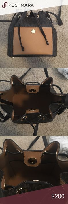 Michael Kors Greenwich Monogram Small Bucket Bag This bag is the perfect early Christmas gift! It comes with the duster bag and is in store bought, untouched condition. Never used, never worn. No flaws at all. No longer accepting offers @ this price.  ❤️  Color: Brown/Peanut  *sold out in many places* Michael Kors Bags