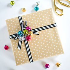 Make this easy and adorable gift topper with any collection of mini ornaments!