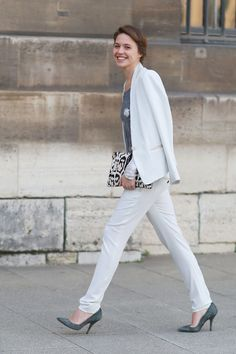 A crisp white suit. Paris Fashion Week #streetstyle Fall 2014 #Pfw