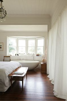 Chic bedroom bathtub together in a small space. vanessa partridge's home, designed by chelsea hing, photo nik epifanidis. via the design files. Decor, Home, Bedroom Inspirations, Home Bedroom, House Styles, House, Bedroom With Bath, House Interior, Room
