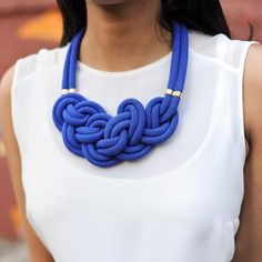 Out of the Blue necklace, a bold and complex original knot that is as lightweight as it is stunning. Benefits education for girls in Bangladesh. Made in the USA. Handmade jewelry. Trendy jewelry.