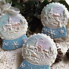 Snow-globes with snowy village church scenes by Teri Pringle Wood