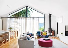 """""""My favourite spot in the house is the settee near the fireplace, where I sit and read to Roko,"""" says Tonci. Fireplace and wood box, Wignells of Melbourne. Cleo (grey) **sofa** and Iko **side table**, [Jardan](http://www.jardan.com.au//?utm_campaign=supplier/ target=""""_blank""""). **Ottoman**, [Molmic](http://www.molmic.com.au//?utm_campaign=supplier/ target=""""_blank""""). **Floor lamp**, [Euroluce](http://euroluce.com.au//?utm_campaign=supplier/ target=""""_blank""""). **Rug**, [Halcyon Lake Rugs and…"""