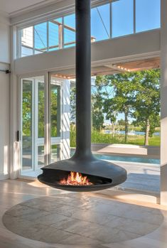 Gyrofocus - Cheminée suspendue à bois créée par la marque Focus #cheminee #bois #design #décoration #salon Hanging Fireplace, Pool Houses, Interior Design, Live, Fireplaces, Design Ideas, Fireplace Modern, Fireplace Set, Indoor Fireplaces