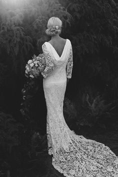 Cowl back wedding dress with long train by Kelsey Genna | Lara Hotz Photography for Hooray Magazine