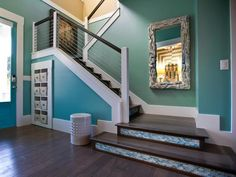 Enhance your staircase's style by sprucing it up with wallpaper, tile, and even wallpaper that looks like tile.