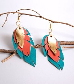 Items similar to navajo triple leather feather earrings in two color combination gold/coral/turquoise or turquoise/gold/coral on Etsy Diy Leather Earrings, Diy Earrings, Leather Jewelry, Leather Craft, Beaded Jewelry, Jewellery, Crea Cuir, Diy Accessoires, Bracelet Cuir