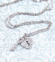 The heart lock and key are often seen as pendants on a pair of necklaces shared by best friends or lovers. These are a symbol of one person holding the key to the other one's heart. When the heart loc