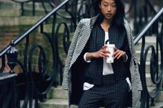 Match patterns in similar colors for a sophisticated take on pattern play. Margaret Zhang of blog Shine by Three in the Tibi tatersol jacket and skinny pant.