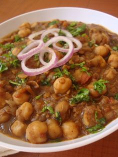 Punjabi Chole is an easy Indian food recipe that is prepared with kabuli chana or chickpeas, spices like coriander, cinnamon, black cardamom and pomegranate seeds and tomatoes. It goes well with bhatura, roti, puris and rice.