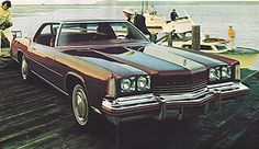 1974 Oldsmobile Toronado. Mom and dad had a bright red one the white vinyl half top and interior