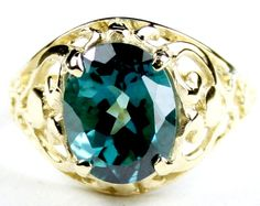 R004, Paraiba Topaz, 10KY Gold Ring * Stone Type - Paraiba Topaz * Approximate Stone Size - 10x8mm  * Approximate Stone Weight - 3.3 cts  * Jewelry Metal - Solid 10k Yellow Gold * Approximate Metal Weight - 2.8 grams  * Ring Size - Size selectable during checkout * Our Warranty - A full year on workmanship  * Our Guarantee - Totally unconditional 30 day guarantee