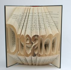 what a book makes you do - repurposed book by Isaac Salazar.  Done by folding the pages - amazing!