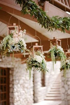 rustic wedding lanterns metal golden lanterns with greenery and white flowers are suspended rebecca yale photography