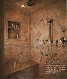 the large steam shower, wrapped in limestone tile, has a rainhead, a hand spray, and multiple wall sprays. A roomy bench and niches for toiletries are built in