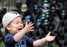 A Boy Plays with Soap Bubbles at the Tbilisi Zoo, 2012, by Vano Shlamov
