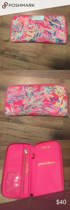 Large Lily Pulitzer wallet This wallet is in like new condition it does have a few pen marks but nothing noticeable. It's is a beautiful bright wallet. Lilly Pulitzer Bags Wallets