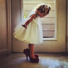A picture of the flower girl in the brides shoes!