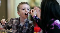 chinese new year  Parker Lucas, 6, gets a little help from his mom Carrie Lucas, both from Nazareth, using the chop sticks, as students and host families with New Oasis Education celebrate the Chinese New Year Sunday at Wesley United Methodist Church in Bethlehem.  http://www.mcall.com/news/local/bethlehem/mc-bethlehem-chinese-students-new-year-20150222-story.html#page=1&lightbox=82888245&slide=2