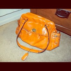 Vibrant Orange Handbag This handbag is fabulous, with lots of pockets and space for necessities. Love it's vibrant orange hue, and side pockets. In great condition, clean inside and out. Bags