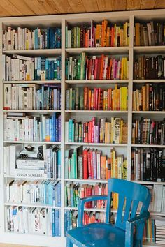 I've seen a lot of color-coordinated bookshelves, but I like how this one is organized chaos (but how on earth are they going to find the books!).