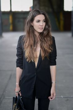 Cindy van Der Heyden is wearing a leather trousers from Gestuz, nude top from American Apparel and a long black blazer from H&M