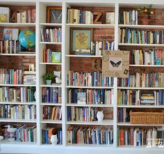 Designing library with books. DIY Ikea built in bookshelves.