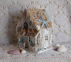 Fairy Shells Fairy Cottage.    Some little fairy has a beach house! Starfish, netting, beach shells, sanddollars, pretty feathers, tiny