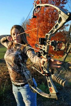 Hot girl with bow and arrow in camo