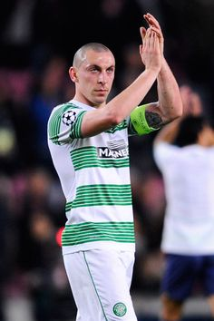 Scott Brown of Celtic FC acknowledges Celtic FC supporters at the end of the Champions League Group H match between FC Barcelona and Celtic FC at Camp Nou on December 11, 2013 in Barcelona, Catalonia.