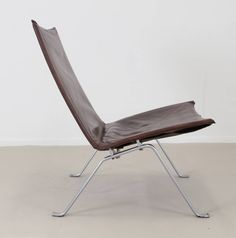 EKC PK22 with Brown Original Leather Cover by Poul Kjaerholm | From a unique collection of antique and modern lounge chairs at https://www.1stdibs.com/furniture/seating/lounge-chairs/
