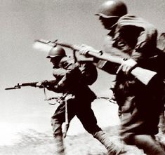 Russian soldiers advance with fixed bayonets, Operation Bagration. 22 June 1944 [via]