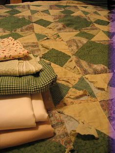 How to repair a quilt ~ sew new pieces where the old ones have shredded.