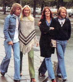 The four ABBA people happily taking a walk through the wet streets of Stockholm in the autumn of 1976.